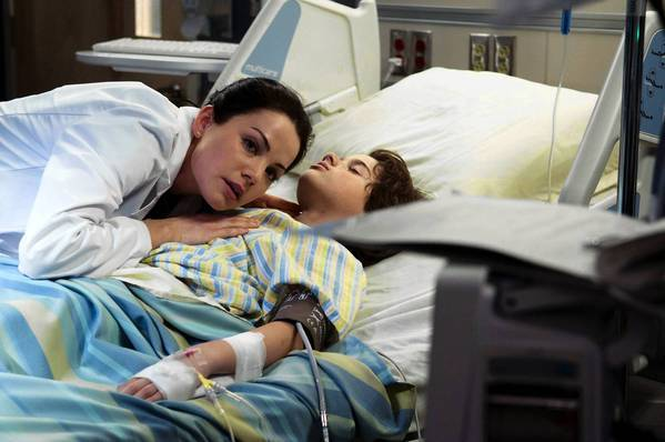 "Erica Durance, left, stars in ""Saving Hope."""