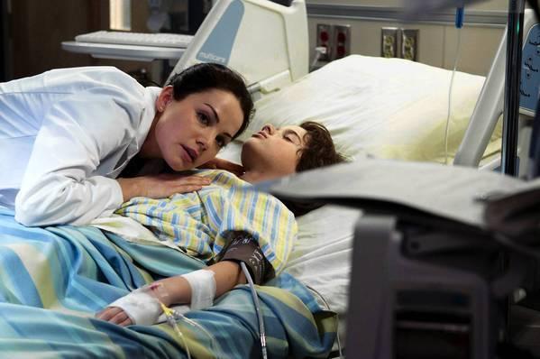 """Erica Durance, left, stars in """"Saving Hope."""""""