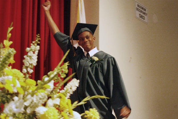 Blair's Tilden Campbell throws his fist in the air before receiving his high school diploma during his graduation ceremony, which took place at Pasadena High School on Tuesday, June 5, 2012.