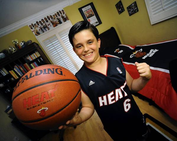 Nine year-old Jack Meyer is a huge fan of the Miami Heat and was heard on the national broadcast of last night's game five yelling out positive messages to Heat players including LeBron James and Dwyane Wade as they exited the court in defeat. This is Jack in his Heat-filled bedroom of his family's Gables By The Sea home.