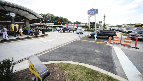 Cars line up to enter the new Sonic drive-in restaurant which opened for business Wednesday on Dual Highway near Edgewood Drive.