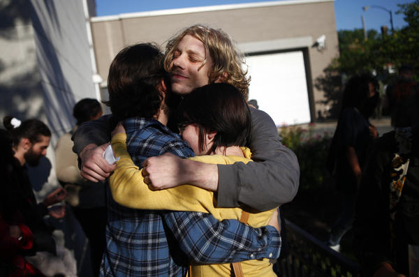 An Occupy Chicago protester, calling himself Charlie Guy, center, is hugged by fellow protesters early Thursday after being released from the Chicago Police Department's Central District Headquarters. Twelve protesters where arrested around 7 p.m. Wednesday on Ohio Street and Michigan Avenue.