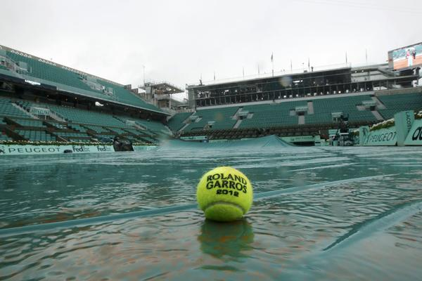 A ball is seen in a puddle on the Philippe Chartrier court as rain stops play during the French Open tennis tournament at the Roland Garros stadium in Paris June 7, 2012.