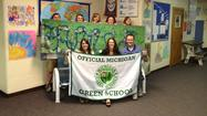 INDIAN RIVER -- Maureen Stine, area coordinator of the Michigan Green Schools, recently presented Inland Lakes Schools with Cheboygan County's first Green School flag.