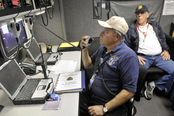Joe Abruzzi, left, a former chief and now a firefighter of the Weston Fire Dept., and Andy Kalapir, assistant chief of the Southport Fire, are part of the communication team of the Fairfield County Hazardous Incident Responce Team.  The team performed a cross patch drill, in which they bridged desperate frequencies , VHF to UHF, as part of their drill.