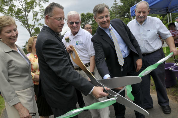 From left, Rep. Pam Sawyer, of Bolton, Manchester Mayor, Leo Diana, William O'Niell, Commissioner of the CT DOT Jame Redeker, and State Sen. Steve Cassano, of Manchester, participate in the ceremonial ribbon cutting along the Charter Oak Greenway in Manchester.
