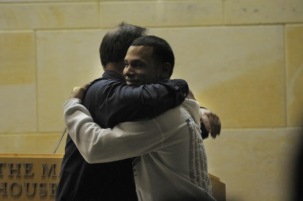 Domingo Galarza, 19, a graduating senior at the Law and Government Academy at Hartford Public High School, hugs his swimming coach, Harry Bellucci, after receiving an award and scholarship during a ceremony for exceptional seniors at the Mark Twain and Museum in Hartford.