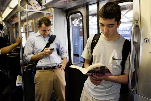 CTA riders reading during their ride