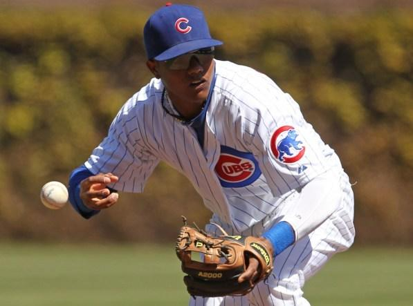 Starlin Castro commits an error against Milwaukee in April 2012. (Chicago Tribune)