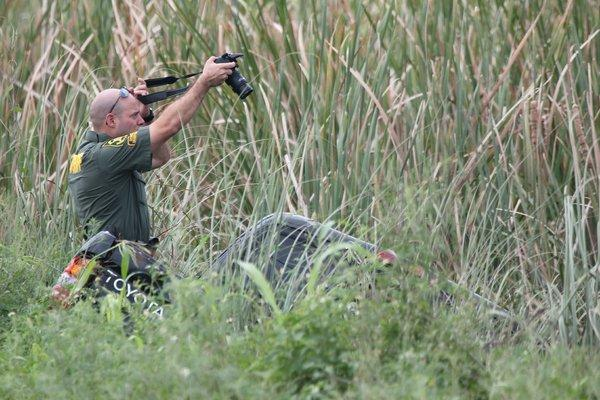 BSO Traffic Homicide Unit Det. Carlos De Jesus photographs the Toyota pickup truck that landed in an Everglades canal in southwest Broward.