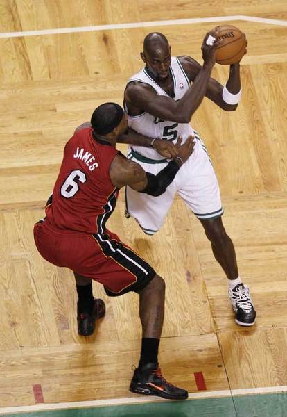 Boston Celtics forward/center Kevin Garnett (5) is guarded by Miami Heat forward LeBron James (6) during the first quarter of game six of the Eastern Conference finals of the 2012 NBA playoffs at TD Garden.