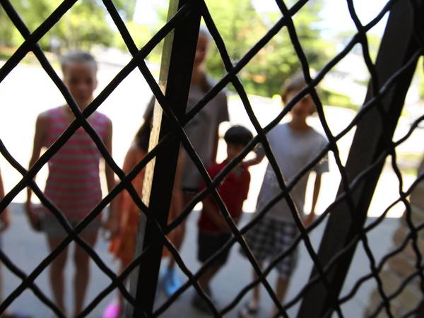 Students peer through the metal bars at Chute Middle School in Evanston.