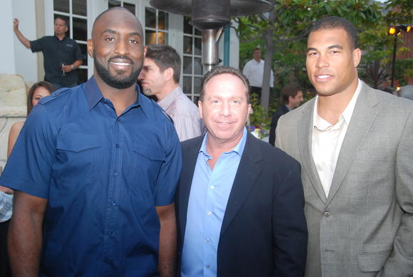 From left: DeShaun Foster (former NFL running back, Barry Saywitz (event host) and Jason Bell (former NFL cornerback) appeared at the OC Bruin Bash.