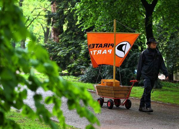 Marc Olejak pulls a cart to promote the Pirate Party in Duesseldorf, Germany, last month. Days later, he won a seat in the parliament of North Rhine-Westphalia, Germany's most populous state.