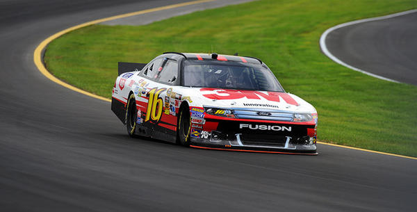 Greg Biffle driver of the #16 3M/Rite Aid/NextCare Ford navigates the third turn on the newly paved Pocono Raceway during the second-day of the test sessions prior to the Pocono 400 race weekend.