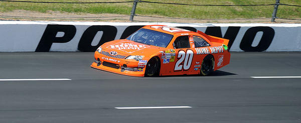 Joey Logano driver of the #20 Home Depot Toyota navigates down the front straightaway on the newly paved Pocono Raceway during the second-day of the test sessions prior to the Pocono 400 race weekend.