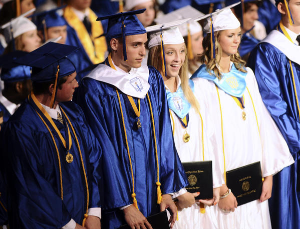 Graduating seniors David Bright, Benjamin Cornwell, Emily Winters and Rachel House look out into the audience after receiving their diplomas at the 96th Commencement Program for Clear Spring High School held on Thursday evening for the graduating class of 2012.