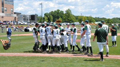 North Star varsity baseball players and coaches celebrate their victory over District 10 champion Saegertown on Thursday at North Allegheny High School in Wexford. The Cougars will advance to the PIAA Class AA tournament semifinals.