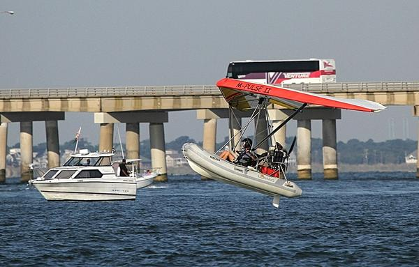 This ultralight flies by the Chesapeake Bay Bridge-Tunnel before the OpSail 2012 Parade of Sail Friday morning.