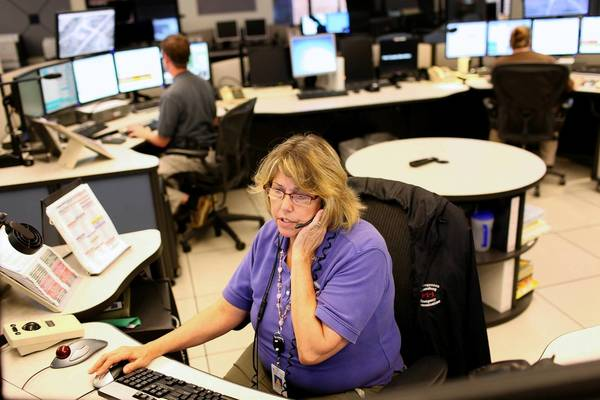 Shift leader Tracy Walton answers a call at the regional 911 communication center in York County on Thursday. This joint center covers York County, Poquoson and Williamsburg.