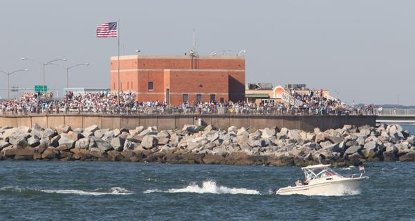 A crowd gathers at the Chesapeake Bay Bridge-Tunnel to watch the tall ships during the Opsail 2012 Parade of Sail on Friday.