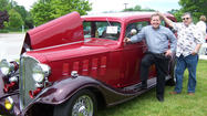 First Presbyterian Church of Harbor Springs pastor Jim Pollard (from left) and Guy Britton of Harbor Springs, cruise-in coordinator, pose with Britton's 1933 Buick. The church will host its fifth annual car show 9 a.m.-noon Father's Day, Sunday, June 17.