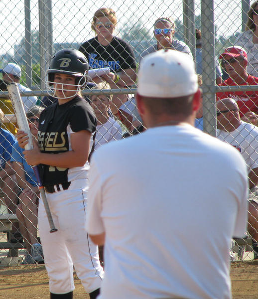 Lauren Richards of Boyle County looks to coach Brian Deem for instructions before she leads off the first inning in the Rebels' first state softball tournament appearance. Richards had a hit and walked twice in Boyle's 4-1 victory over Oldham County on Thursday in Owensboro.