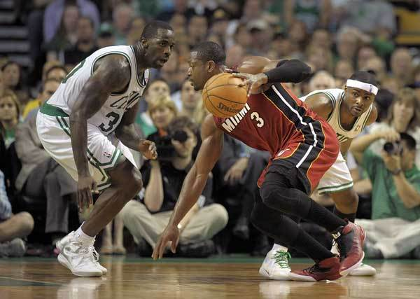 Miami Heat guard Dwyane Wade changes direction on Boston Celtics forward Brandon Bass during the fourth quarter of Game 6 of the Eastern Conference Finals, Thursday, June 7, 2012, at TD Garden.