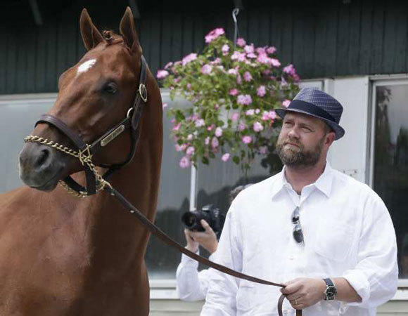 I'll Have Another and trainer Doug O'Neill at the news conference announcing that the horse will be retired to stud.