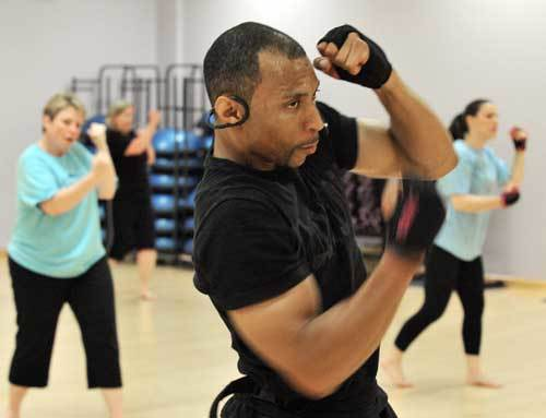 Phil Hicks instructs a piloxing class.
