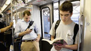 On the 'L,' e-books change spy game