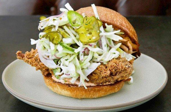 The fried chicken sandwich with a spicy slaw and rooster aioli at Son of a Gun.