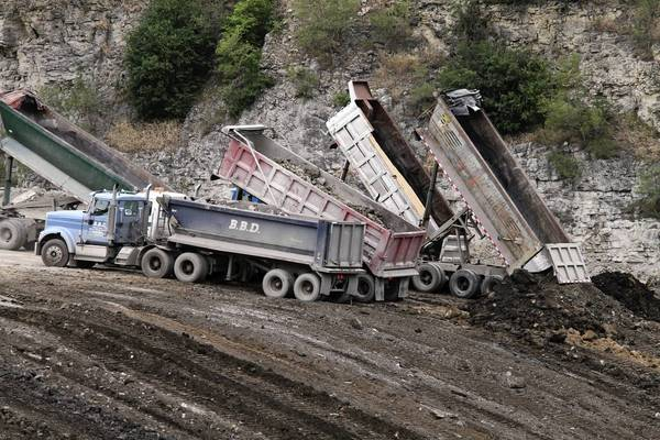Trucks dump their loads of dirt and debris from construction sites into the Reliable Materials quarry at 4401 S. First Ave. in Lyons.