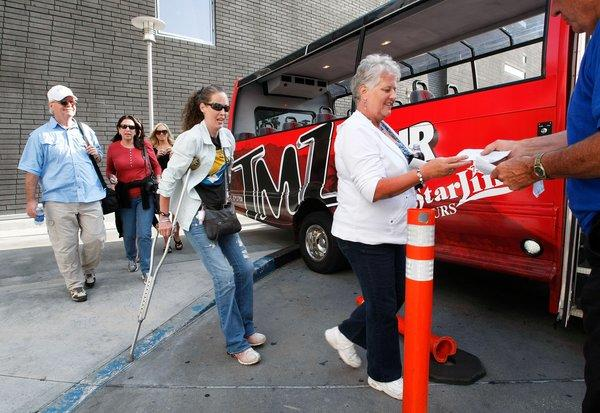 Tourists board a TMZ bus for a gossip-laden voyage around Hollywood and Beverly Hills guided by a real live papa... ratzo.