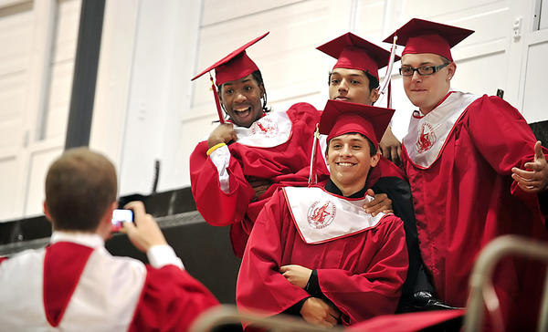 North High classmates Michael Edwards, back left, Blake Lyles, back center, Jared Line, back right, and Sergio Galvan, front center, pose for a picture taken by Chad Feigley in the gym before their graduation ceremony at North Hagerstown High School Friday.