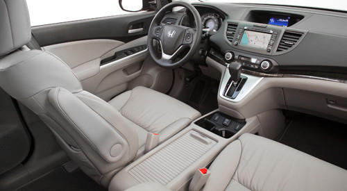 The 2011 Honda CR-V had a huge center console, but only on higher trim levels. Honda made it standard across the CR-V lineup for 2012. The gigantic 10.8-liter console bin easily held my large purse. It can also hold a laptop; a sliding cover keeps it hidden. Smaller cubbies on the side of the console are an added bonus and good for holding smaller items.