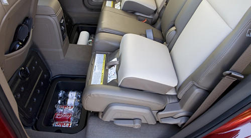 Like the Dart, the Dodge Journey passenger seat cushion flips up to reveal a hidden storage bin large enough to store a purse, umbrella, camera, planner or headphones. Also hidden are two under-floor storage compartments in the second row.