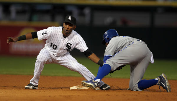 Alexei Ramirez puts a tag on Toronto Blue Jays' Rajai Davis Wednesday.