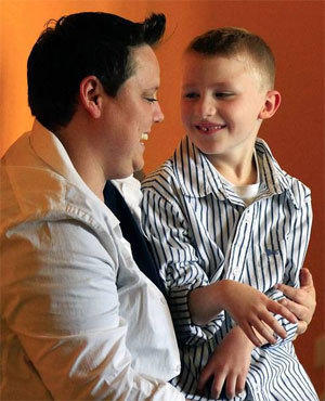 Jennifer Tyrrell, shown with her 7-year-old son, Cruz, wrote a petition calling on the Boy Scouts to end its ban on gay Scouts and troop leaders.