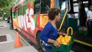 A bus loaded with pears, asparagus and other fruits and vegetables soon will start rolling through South Side neighborhoods in a circuit Mayor Rahm Emanuel likened to a healthy ice cream truck route.