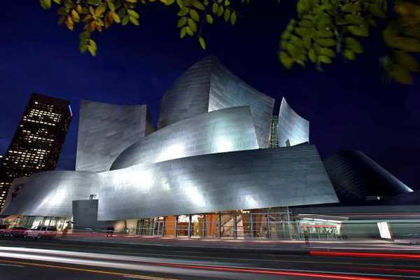 The Walt Disney Concert Hall lights up Grand Avenue at night.