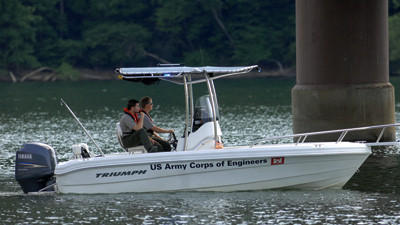 Matt Slezak and Vince Klinkner, park rangers with the U.S. Army Corps of Engineers, search the water and conduct sonar tests at the Youghiogheny Dam late Friday afternoon.
