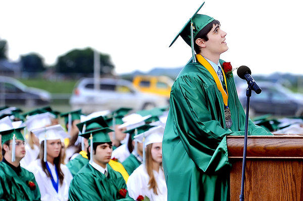 James Buchanan High School Valedictorian Austin Keller looks skyward and thanks his sister, whose passing helped Keller realize the important things in life, during Friday's commencement at the school's Rocket Field.