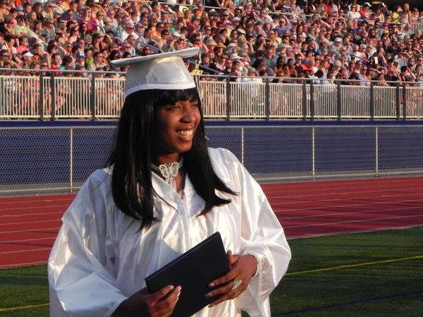 Jessica Burney is all smiles after receiving her diploma at Friday's commencement at Trojan Stadium at Chambersburg Area Senior High School.
