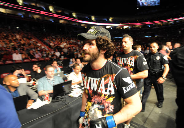 Charlie Brenneman leaves the octagon after losing to Erick Silva during the UFC's Harley-Davidson Hometown Throwdown on FX held at the BankAtlantic Center. 6/8/12. Jim Rassol, Sun Sentinel.