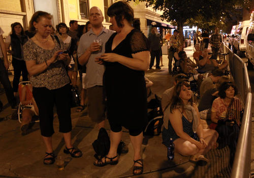 People gather on Sheffield Avenue to listen as Roger Waters performs Friday, June 8, 2012 at Wrigley Field.