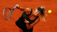 PARIS -- As they gazed at each other across the net before their French Open final, 24 cms in height separated Maria Sharapova from Sara Errani - when the action began it was a country mile as the Russian won the title and completed the career grand slam.