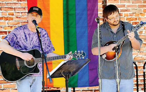 The acoustic duo Serendipity Doo-Da, composed of Dalton Fleming, left, on guitar and Ron Webb, right, on mandolin, performed Saturday during the Hagerstown Hopes rally at University Plaza on West Washington Street in Hagerstown. The rally was in support of the GBLTQ community.
