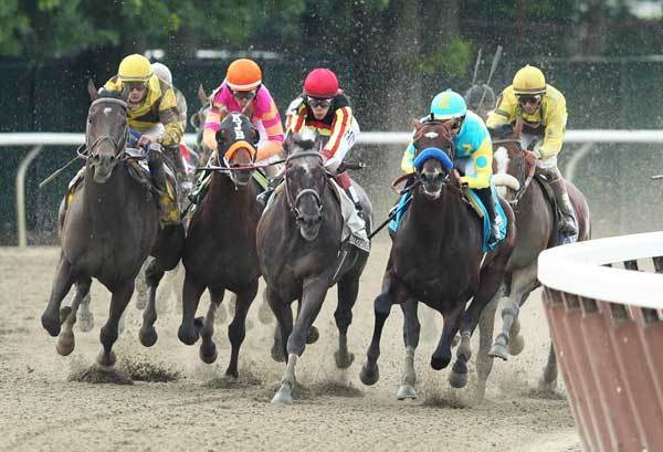 Julien Leparoux aboard Atigun (left), Ramon Dominguez aboard My Adonis (second from left), Junior Alvarado aboard Unstoppable U (center) and Mike Smith aboard Paynter (second from right), and John Velazquez aboard Union Rags (right) make the final turn 144th running of Belmont Stakes at Belmont Park.
