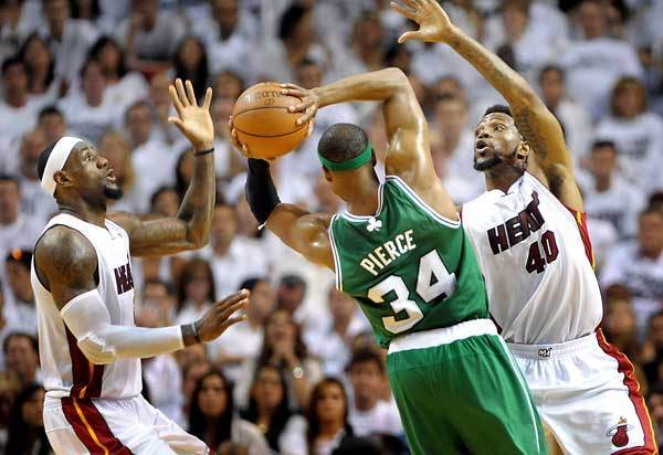 Boston's Paul Pierce is double-teamed by LeBron James and Udonis Haslem.